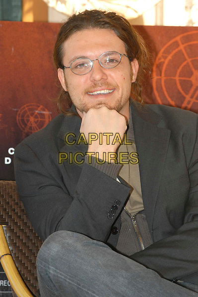 """GIACOMO MARTELLI.Photocall for """"The Listening"""" (In Ascolto) at the Eden Hotel, Rome, Italy..March 19th, 2006.Ref: CAV.half length director glasses hand.www.capitalpictures.com.sales@capitalpictures.com.© Capital Pictures."""