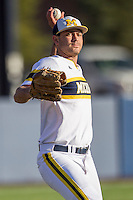 Michigan Wolverines pitcher William Tribucher (22) makes a throw to first base against the Central Michigan Chippewas on March 29, 2016 at Ray Fisher Stadium in Ann Arbor, Michigan. Michigan defeated Central Michigan 9-7. (Andrew Woolley/Four Seam Images)