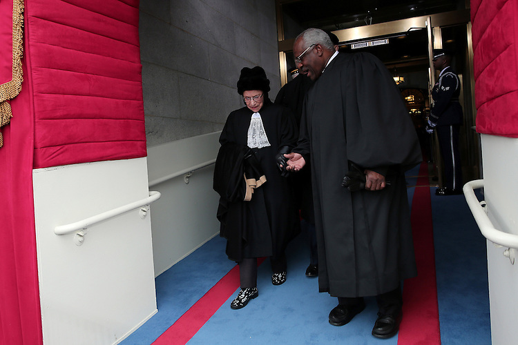 WASHINGTON, DC - JANUARY 21: Justice Ruth Bader Ginsburg and Justice Clarence Thomas arrive during the presidential inauguration on the West Front of the U.S. Capitol January 21, 2013 in Washington, DC.   Barack Obama was re-elected for a second term as President of the United States.  (Photo by POOL Win McNamee/Getty Images)