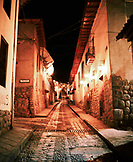 Peru, Cusco, South America, Latin America, a street at night in Cusco.