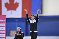 SCHAATSEN: CALGARY: Olympic Oval, 09-11-2013, Essent ISU World Cup, podium 500m, Jenny Wolf (GER), Sang-Hwa Lee (KOR), ©foto Martin de Jong