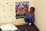 preschool: Headstart 3-4 year olds boy in corner of room, isolated, sad, crying, time out