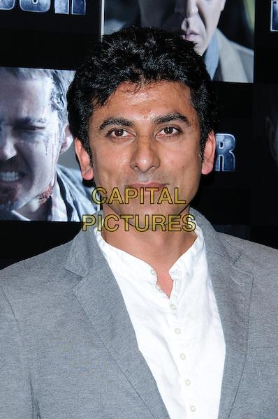 Ace Bhatti.UK premiere of 'Four' at The Empire Cinema - Arrivals, London, England..October 10th, 2011.headshot portrait grey gray jacket white shirt.CAP/CJ.©Chris Joseph/Capital Pictures.