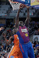 FC Barcelona Regal's Nathan Jawai (r) and Valencia Basket Club's Florent Pietrus during Spanish Basketball King's Cup Final match.February 07,2013. (ALTERPHOTOS/Acero)