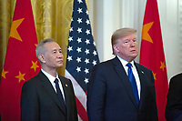 United States President Donald J. Trump and Liu He, China's vice premier, listen to remarks before signing a trade agreement between the United States and China in the East Room of the White House in Washington D.C., U.S., on Wednesday, January 15, 2020.  <br /> <br /> Credit: Stefani Reynolds / CNP/AdMedia