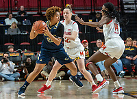COLLEGE PARK, MD - NOVEMBER 20: Sara Vujacic #32 and Diamond Miller #14 of Maryland defend against Ariel Stephenson #25 of George Washington during a game between George Washington University and University of Maryland at Xfinity Center on November 20, 2019 in College Park, Maryland.
