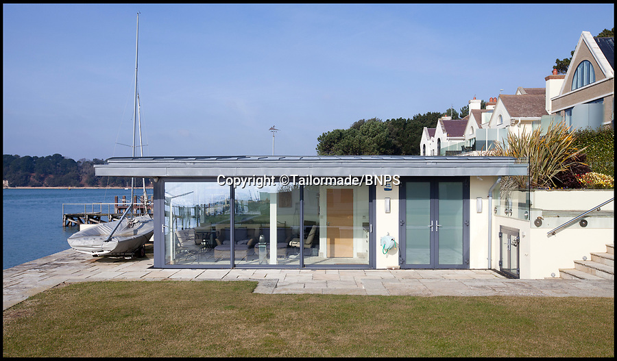BNPS.co.uk (01202) 558833<br /> Pic: Tailormade/BNPS<br /> <br /> Boathouse/office in the grounds...<br /> <br /> This state of the art mega-home is for sale on the exclusive millionaires playground of Sandbanks in Poole, Dorset.<br /> <br /> The biggest, most expensive, and luxurious home ever to come on the market on the tiny peninsula, it is now selling for a cool £8.75m.<br /> <br /> Called The Moorings, the harbour front mansion has stunning sea views, and is on one of the most enviable plots on Millionaire's Row.<br /> <br /> Its owners, entrepreneur Chris Thomas and wife Sue, spent a staggering £5.5m building the palatial home that has been compared to a five star hotel.<br /> <br /> Spread over 13,000 sq ft - the equivalent size of seven detached houses - the state-of-the art property comes with five en suite bedrooms, three reception rooms, an office, cinema room, indoor swimming pool, sauna, gym, gate house and boat house.