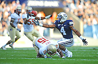 Sept. 19, 2009; Provo, UT, USA; BYU Cougars wide receiver (4) O'Neill Chambers catches a pass under pressure from Florida State Seminoles cornerback (15) Ochuko Jenije in the second quarter at LaVell Edwards Stadium. Mandatory Credit: Mark J. Rebilas-