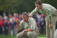 Straffin Co Kildare Ireland. K Club Ruder Cup...European Ryder Cup team members Lee Westwood and Darren Clarke line up thier putt on the 18th green on the opening fourball session on the first day of the 2006 Ryder Cup, at the K Club in Straffan, Co Kildare, in the Republic of Ireland, 22 September 2006..Photo: Eoin Clarke/ Newsfile..