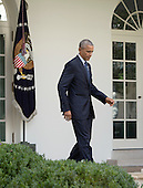 United States President Barack Obama walks to the lectern to make a statement on the ratification of The Paris Agreement which deals with greenhouse gases emissions mitigation, adaptation and finance starting in the year 2020 within the United Nations Framework Convention on Climate Change (UNFCCC) in the Rose Garden of the White House in Washington, DC, October 5, 2016.<br /> Credit: Chris Kleponis / Pool via CNP