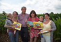 09/07/14<br /> <br /> L/R: Alfie Hughes (20 months), with his mum Lisa Moran, Axel Scheffler,  Julia Donaldson and Oliver Heighington (20 months) and his mum Nina Heighington.<br /> <br /> A ten acre field of maize is turned into a giant scarecrow maze. The characters are from from Julia Donaldson's new book - The Scarecrows' Wedding. The Gruffalo author was joined by the books' illustrator, Axel Scheffler to open the maze today at The National Forest Adventure Farm, Tattenhill, Staffordshire. <br /> All Rights Reserved: F Stop Press Ltd. +44(0)1335 300098   www.fstoppress.com.