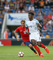 Kortney Hause (Wolverhampton Wanderers) of England & Martin Odegaard (Real Madrid) of Norway in action during the International EURO U21 QUALIFYING - GROUP 9 match between England U21 and Norway U21 at the Weston Homes Community Stadium, Colchester, England on 6 September 2016. Photo by Andy Rowland / PRiME Media Images.