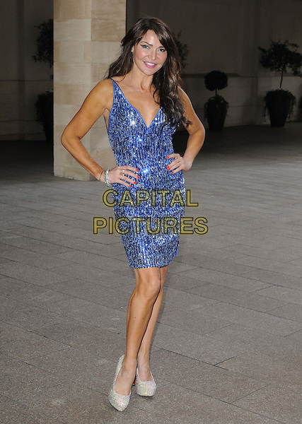 Lizzie Cundy.The Jameson Empire Film Awards 2012, Grosvenor House Hotel, Park Lane, London, England..March 25th, 2012.full length blue dress hands on hips sequins sequined .CAP/CAN.©Can Nguyen/Capital Pictures.