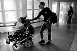 Maryia Amin, a six-year-old Palestinian paralysed from the neck down when the car she was travelling in was caught in a missile attack on a leader of the Islamic Jihad militant group in Gaza, is accompanied by her father Hamdi  to a hearing at Israel's Supreme Court in Jerusalem July 8, 2008. Amin is fighting an order to move her from a rehabilitation centre in Israel to the occupied West Bank.The Defence Ministry, which has covered Maria's medical expenses and sponsored her father and younger brother to live with her at a Jerusalem hospital, has been seeking since last year to send her to Ramallah's Abu Raya Rehabilitation Centre.
