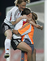MAR 15, 2006: Faro, Portugal:   German midfielder (17) Melanie Behringer,  defender (5) Annike Krahn and goalkeeper (1) Silke Rottenberg celebrates their win over the USWNT in the finals of the Algarve Cup in Faro, Portugal.