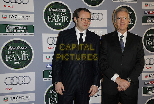 Stefano Domenicali & guest.attended the Motor Sport Hall Of Fame induction ceremony, Royal Opera House, Covent Garden, London, England..February 25th, 2013.half length black suit tie white shirt glasses.CAP/CAN.©Can Nguyen/Capital Pictures.