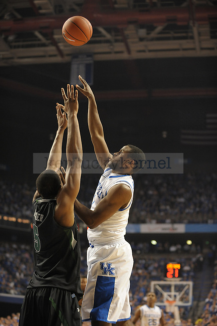 Darius Miller (1) takes a jump shot during the first half of the University of Kentucky Basketball game against Loyola at Rupp Arena in Lexington, Ky., on 12/22/11. UK led at half 45-39. Photo by Mike Weaver | Staff