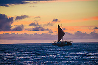 North Shore, Oahu, Hawaii (December 5, 2013) Hokule'a Voyaging Canoe setting sail after the ceremony. -- The 29th annual Quiksilver In Memory of Eddie Aikau, the original one-day big wave invitational surfing event, officially opened its holding period with the traditional Hawaiian Opening Ceremony at Waimea Bay today, December 5, at 3pm. Event Invitees and Alternates joined with the Aikau Family and Hawaiian Kahu Billy Mitchell to honor Aikau and welcome the winter big wave period. The Hokule'a, the replica of a traditional Hawaiian voyaging canoe anchored in The Bay during the ceremony with the crew coming ashore and joining the circle. Photo: joliphotos.com