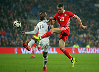 Marley Watkins of Wales (R) takes a shot off target while closely marked by Felipe Baloy of Panama during the international friendly soccer match between Wales and Panama at Cardiff City Stadium, Cardiff, Wales, UK. Tuesday 14 November 2017.