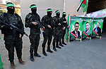 Palestinian militants of the Islamist movement Hamas' military wing Al-Qassam Brigades  stand guard during a deliver consolations of three martyrs in the West Bank, in Gaza City on December 13, 2018. Photo by Mahmoud Naser