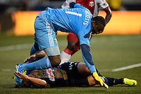 Portland Timbers goalkeeper Donovan Ricketts (1) goes over the top of Daniel Cruz (44) of the Philadelphia Union. The Philadelphia Union and the Portland Timbers played to a 0-0 tie during a Major League Soccer (MLS) match at PPL Park in Chester, PA, on July 20, 2013.