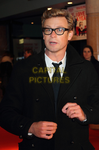 Simon Baker.attends the UK Premiere of 'I Give It A Year', Vue West End cinema, London, England, UK, 24th January 2013..half length black coat tie glasses white shirt .CAP/ROS.©Steve Ross/Capital Pictures