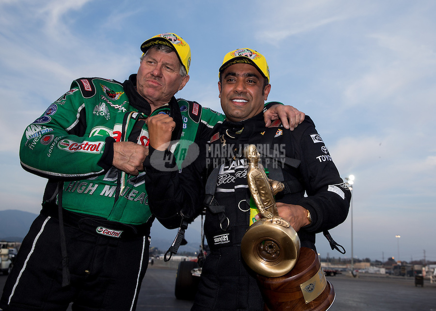 Feb 9, 2014; Pomona, CA, USA; NHRA funny car driver John Force (left) celebrates with top fuel dragster winner Khalid Albalooshi after winning the Winternationals at Auto Club Raceway at Pomona. Mandatory Credit: Mark J. Rebilas-