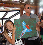 Sean Carrigan & McKenna auction painting -  Actors from Y&R, General Hospital and Days donated their time to Southwest Florida 16th Annual SOAPFEST at the Cruisin' and Schmoozin' Marco Island Princess in Marco Island, Florida on May 24, 2015 - a celebrity weekend May 22 thru May 25, 2015 benefitting the Arts for Kids and children with special needs and ITC - Island Theatre Co.  (Photos by Sue Coflin/Max Photos)