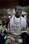 A member of the choir of the Christ the King Catholic parish in Malakal, Southern Sudan, sings and dances during Mass on November 21, 2010. His shirt encourages participation in a January 2011 referendum on the region's independence from the government in Khartoum. NOTE: In July 2011 Southern Sudan became the independent country of South Sudan.