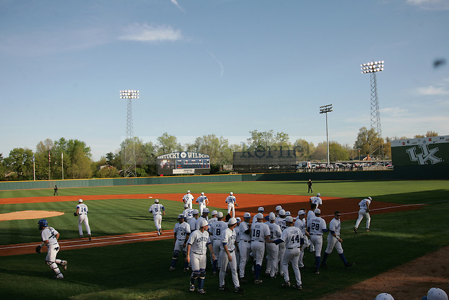The UK baseball team runs onto the field before the UK vs. WKU baseball game at Cliff-Hagan Stadium in Lexington, Ky. March 27, 2012. Photo by Brandon Goodwin | Staff