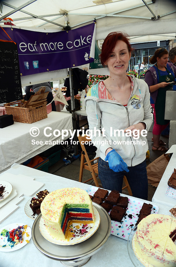 Stallholder, cake stall, open-air market, Shrewsbury, Shropshire, UK, historic, market town, with largely unaltered medieval street plan. It has over 660 listed buildings. July 2014. 201407043198<br />