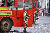 Indian soldiers takes cover behind a fire truck while The Taj Mahal hotel burn during the final gun battle between the Indian commandos and  militants inside the hotel in the early hours of 29th of November 2008 in Mumbai, India.