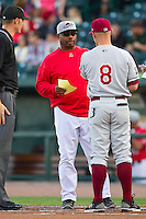 Great Lakes Loons manager Razor Shines (44) exchanges lineup cards with Wisconsin Timber Rattlers manager Matt Erickson (8) at the Dow Diamond on May 4, 2013 in Midland, Michigan.  The Timber Rattlers defeated the Loons 6-4.  (Brian Westerholt/Four Seam Images)