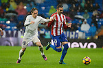 Real Madrid's player Luka Modric and Sporting de Gijon's player Viguera during match of La Liga between Real Madrid and Sporting de Gijon at Santiago Bernabeu Stadium in Madrid, Spain. November 26, 2016. (ALTERPHOTOS/BorjaB.Hojas)