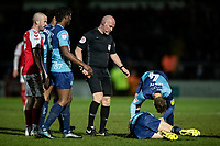 Referee Kevin Johnson reaches for his red card following a challenge on  Wycombe Wanderers' Jason McCarthy (lower right) by Fleetwood Town's Ched Evans (not shown) <br /> <br /> Photographer Andrew Kearns/CameraSport<br /> <br /> The EFL Sky Bet League One - Wycombe Wanderers v Fleetwood Town - Tuesday 11th February 2020 - Adams Park - Wycombe<br /> <br /> World Copyright © 2020 CameraSport. All rights reserved. 43 Linden Ave. Countesthorpe. Leicester. England. LE8 5PG - Tel: +44 (0) 116 277 4147 - admin@camerasport.com - www.camerasport.com