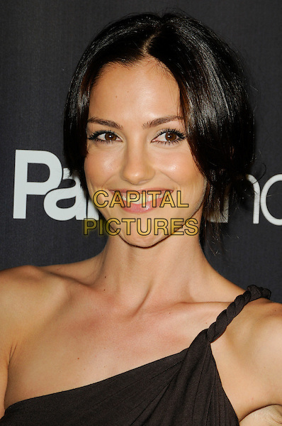 "MINKA KELLY.The Premiere Screening of NBC's ""Parenthood"" at the Directors Guild of America in Los Angeles, California, USA..February 22, 2010   .headshot portrait brown one shoulder .CAP/ROT.©Lee Roth/Capital Pictures"