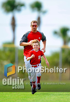 25 February 2012: Washington Nationals' first baseman Adam LaRoche's son Drake runs ahead of his Dad during the first full squad Spring Training workout at the Carl Barger Baseball Complex in Viera, Florida. Mandatory Credit: Ed Wolfstein Photo