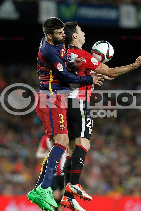 FC Barcelona's Gerard Pique (l) and Athletic de Bilbao's Aritz Aduriz during Supercup of Spain 2nd match.August 17,2015. (ALTERPHOTOS/Acero)