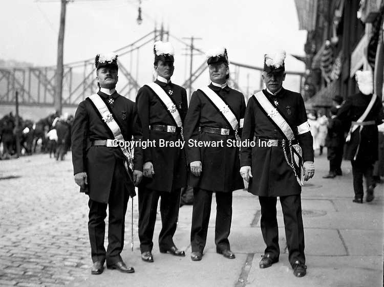 Pittsburgh PA:  Homer Stewart (left) and brother Masons before the annual parade on Water Street - 1904.  Wabash Railroad Bridge is in the background. Homer Stewart, Brady Stewart's father, was prominent in frateral circles. He was a charter member of the Fort Pitt Lodge Free and Accepted Masons; Mount Moriah Council, Royal and Select Masters; 32nd degree member of the Pennsylvania Consistory, Ancient Accepted Scottish Rite, Valley of Pittsburgh; and member of the Syria Temple, Ancient Arabic Order Nobles of the Mystic Shrine.