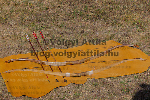 Different types of bows and arrows lay on the ground during the 6th Arrow Rain event celebrating Hungarian war traditions in Opusztaszer, Hungary on June 30, 2012. ATTILA VOLGYI