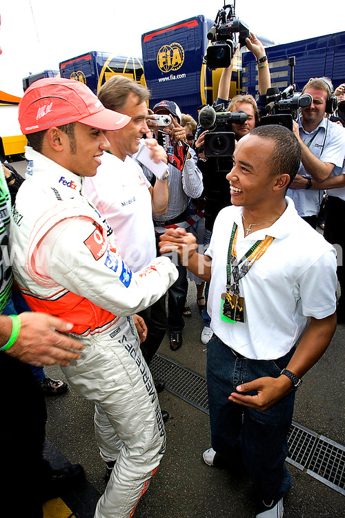 **ALL ROUND PICTURES FROM SOLARPIX.COM**.**WORLDWIDE SYNDICATION RIGHTS**.British driver Lewis Hamilton is congratulated by his young brother Nick after claiming pole postion in the British Grand Prix today..Picture by Andy Tipping..JOB REF:  4230    ATG       DATE: 07.07.07.**MUST CREDIT SOLARPIX.COM OR DOUBLE FEE WILL BE CHARGED* *UNDER NO CIRCUMSTANCES IS THIS IMAGE TO BE REPRODUCED FOR ANY ONLINE EDITION WITHOUT PRIOR PERMISSION*