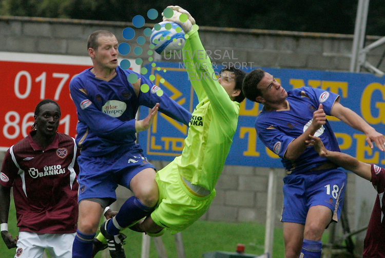 Hearts goalkeeper Janos Balogh saves a header from Kenny Deuchar during the 2-2 draw between St Johnstone FC vs Hearts in the SPL  at McDiarmide Park, Perth.  Pictures by Ben Begley/Universal News and Sport...All pictures must be credited Universals News and Sport (Scotland). .