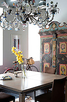 Antique painted wood cupboard and modern table