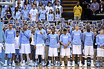 "05 January 2015: UNC students, behind the players, honor the late ESPN broadcaster and UNC alumnus Stuart Scott with ""STU"" signs during a moment of silence. The University of North Carolina Tar Heels played the University of Notre Dame Fighting Irish in an NCAA Division I Men's basketball game at the Dean E. Smith Center in Chapel Hill, North Carolina."