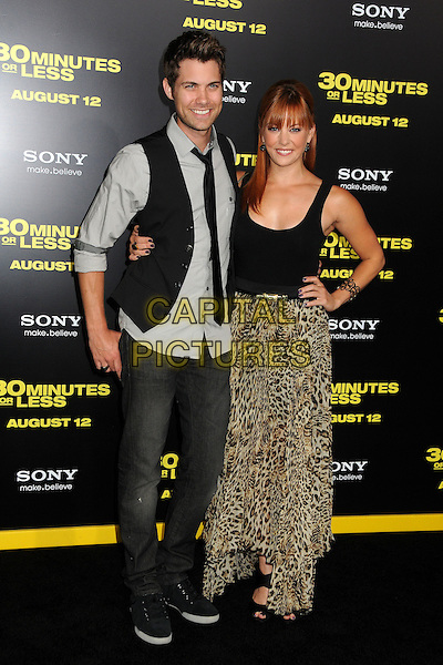 "Drew Seeley and Amy Paffrath.""30 Minutes or Less"" World Premiere held at Grauman's Chinese Theatre, Hollywood, California, USA..August 8th, 2011.full length black tank top sleeveless hands on hips brown beige leopard print skirt jeans denim grey gray shirt waistcoat.CAP/ADM/BP.©Byron Purvis/AdMedia/Capital Pictures."