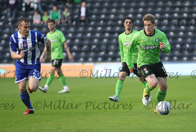 Kris Commons being pursued by Liam Kelly