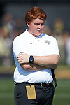 Wake Forest special teams quality control coach Greg Cashman watches the team warm-up prior to the game against the Notre Dame Fighting Irish at BB&T Field on September 22, 2018 in Winston-Salem, North Carolina. The Fighting Irish defeated the Demon Deacons 56-27. (Brian Westerholt/Sports On Film)