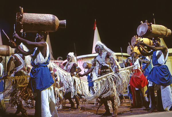 African Pavillion, 1964 World's Fair, Flushing Meadows, New York. Seven foot tall Watusi warriors and a dozen drummers, the personal performers of King Mwambutsa of Burundi, dance a victory celebration. Photo by John G. Zimmerman.