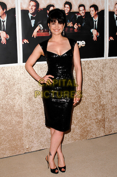 "CARLA GUGINO.The Los Angeles Premiere of the HBO Original Series ""Entourage"", 6th Season held at Paramount Studios in Hollywood, California, USA. .July 9th, 2009 .full length black shiny dress sequins sequined hand on hip.CAP/ROT.©Lee Roth/Roth Stock/Capital Pictures"