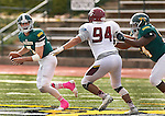 SPEARFISH, SD - OCTOBER 8, 2016 -- Black Hills State quarterback Ryan Hommell #7 tries to evade Zac Owen #94 of Colorado Meas  during their football game at Lyle Hare Stadium in Spearfish, S.D. Saturday. (Photo by Dick Carlson/Inertia)